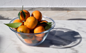 Local clementines, just picked, sunshine, glass, marble...
